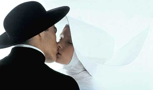A priest and nun kissing